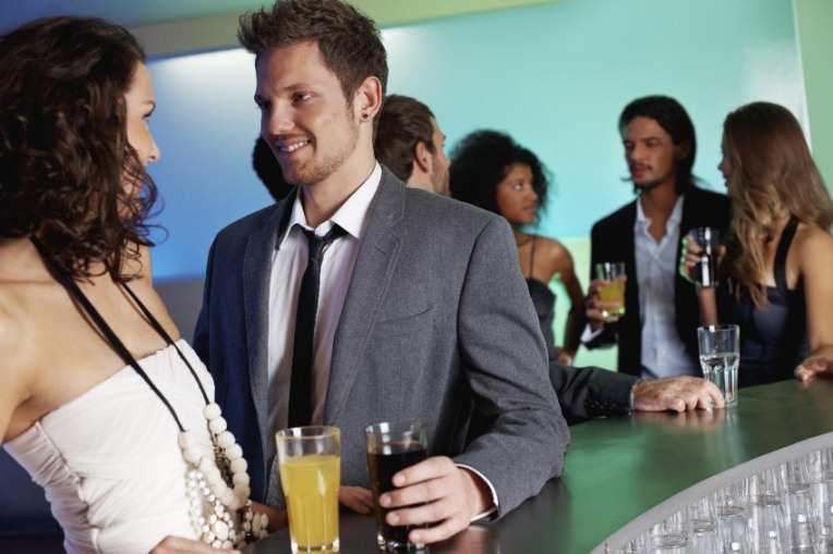 Attractive woman with handsome man at bar counter
